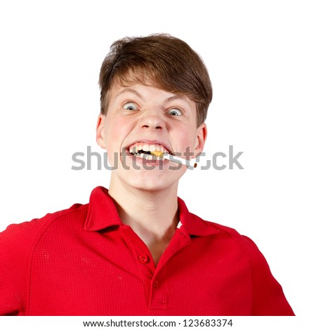 A teenage boy turning into a monster while smoking - stock photo