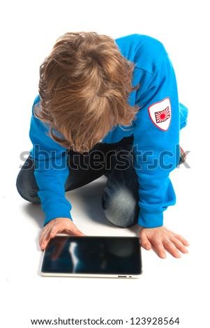 a teenage boy with a tablet