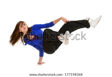 A Teenage Break Dance Girl in Action Holds  a Hand Stand Pose - stock photo