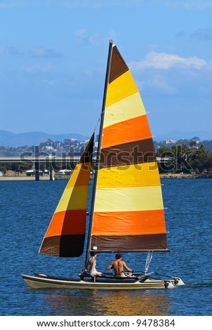 A teenage couple is sailing in Mission Bay, San Diego, California. - stock photo