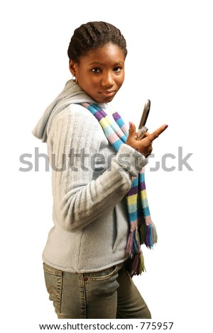 A teenage girl flipping open a cell phone.  With clipping path.