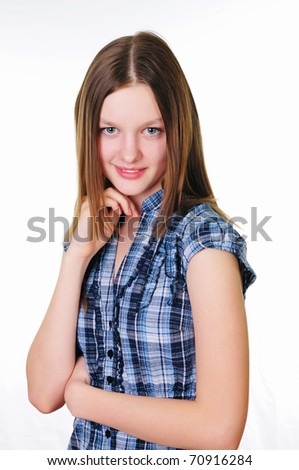 a teenage girl in studio against white background