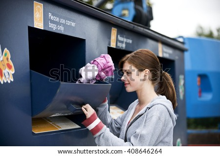 A teenage girl recycling clothes - stock photo
