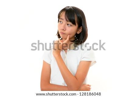 A teenage girl uneasy look - stock photo