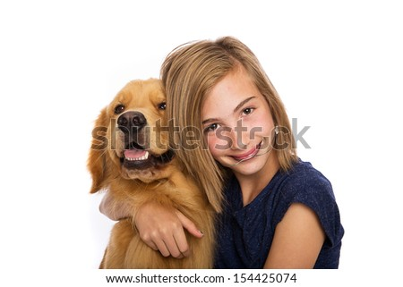 A teenage girl wearing headgear sits with her golden retriever dog - stock photo
