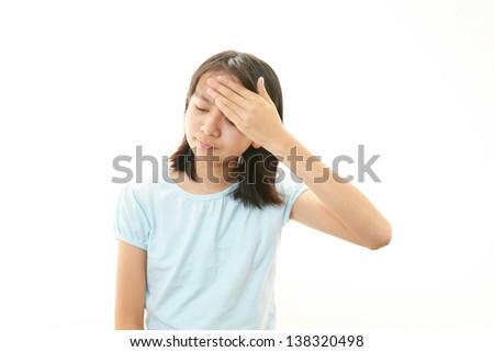 A teenage girl with headache - stock photo