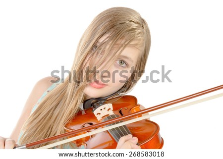a teenage girl with long hair plays violin on the white background - stock photo