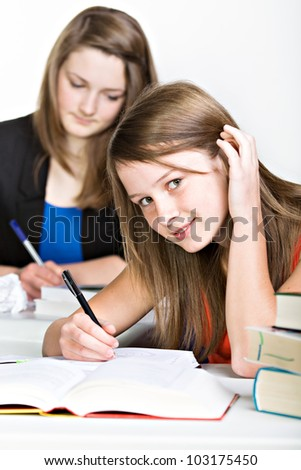 a teenage schoolgirl learning at the table