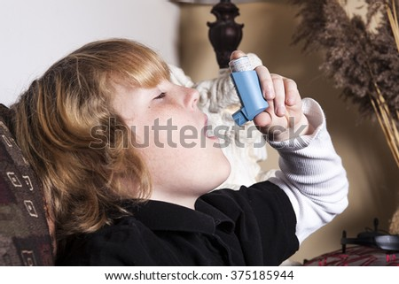 A Teenager Asthma on the living room sofa - stock photo