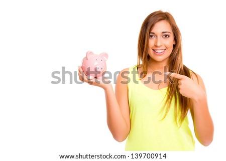 A teenager holding a piggy bank (money box) - savings concept - stock photo