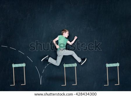 A Teenager Jumping Over Hurdles - stock photo