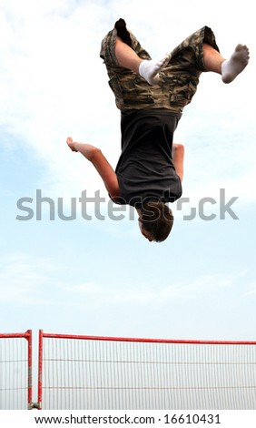A teenager practising on the trampoline. - stock photo