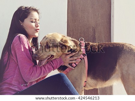 A teenager tryning to kiss her dog in Mar del Plata, Argentina