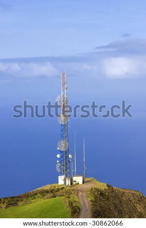 A telecommunication tower with the sea on the background