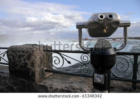 A telescope on the viewing platform at Niagara Falls on the Canadian side. - stock photo