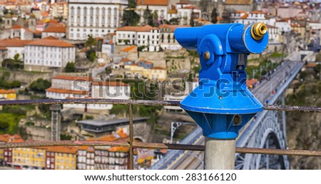 a telescope to explore the city on the viewing platform - stock photo