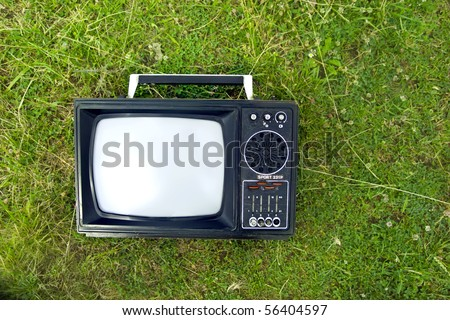 a television on grass - stock photo