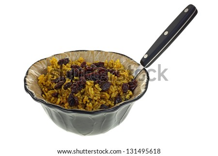 A tempting dish of spicy rice and raisins. - stock photo