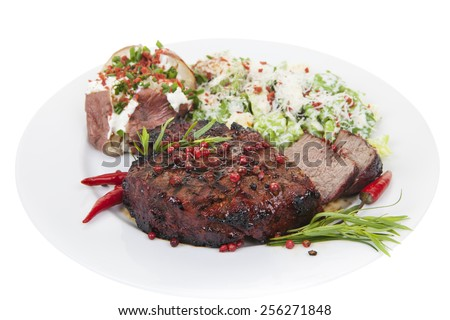 A tenderloin steak dinner cooked medium well, isolated on white background. main focus on steak.