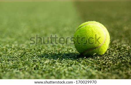 A tennis ball on the playground - stock photo