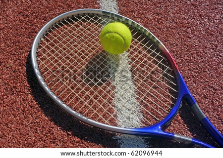 A tennis racket and tennis ball, sports photo - stock photo