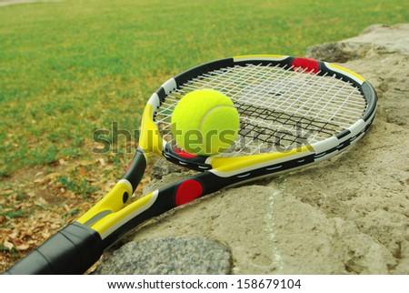 A tennis racket with  tennis ball  - stock photo