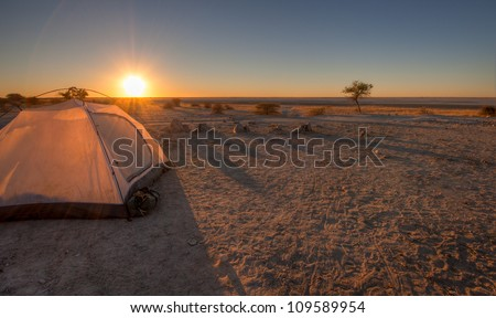 A tent pitched overlooking the makgadikgadi pans - stock photo