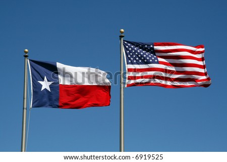 A Texas and US flag boldly flapping in the wind. - stock photo