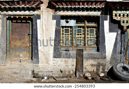 A the front facade of a house in a rural village in the Himalayas, Tibet.