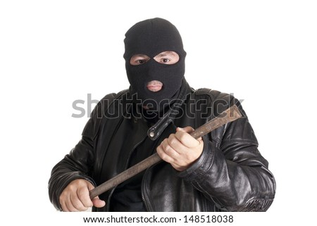 a thief committing a robbery - stock photo