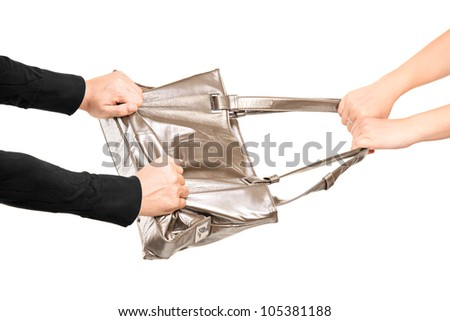 A thief trying to steal a handbag from a girl isolated on white background - stock photo