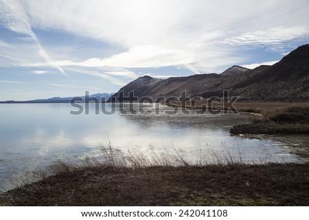 A thin sheen of ice on Tule Lake in Northern California near Klamath Falls. - stock photo
