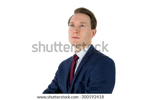 A thoughtful businessman looking away on white background