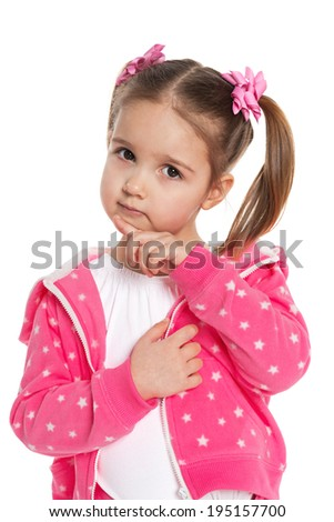 A thoughtful preschool girl in pink on the white background - stock photo