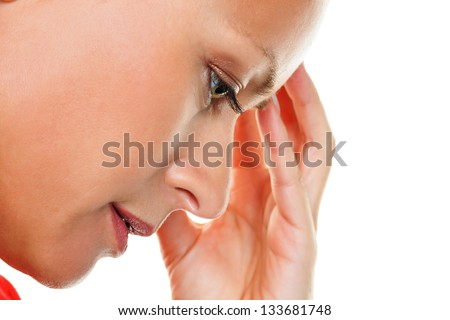 a thoughtful young woman with headaches and migraines. - stock photo