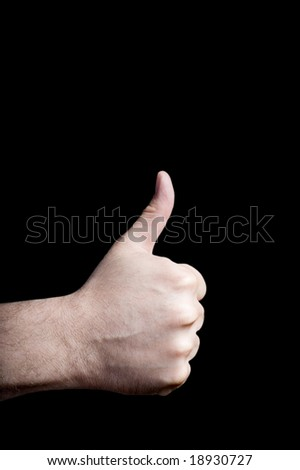 A thumbs up with a black background.