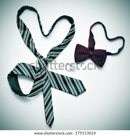 a tie and a bow tie forming hearts and wedding rings, depicting the gay marriage concept, with a retro effect - stock photo