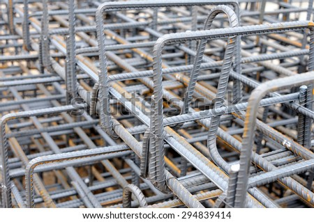 A tied bundle of cold steel bars on construction side - stock photo