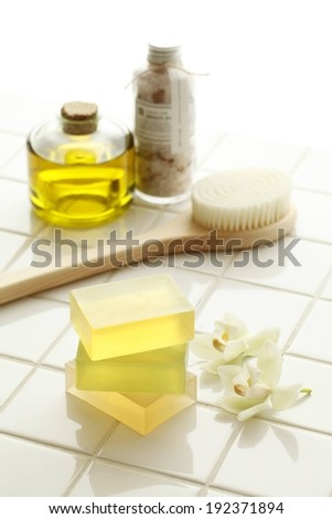 A tile counter with a scrub brush and a bar of soap. - stock photo
