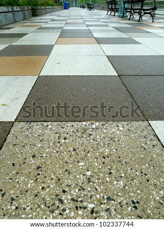 a tiled walkway in a park - stock photo