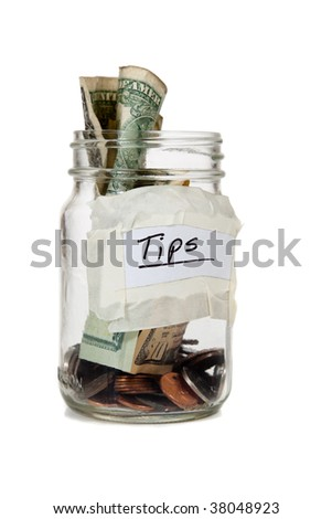 a tip jar with coins and bills