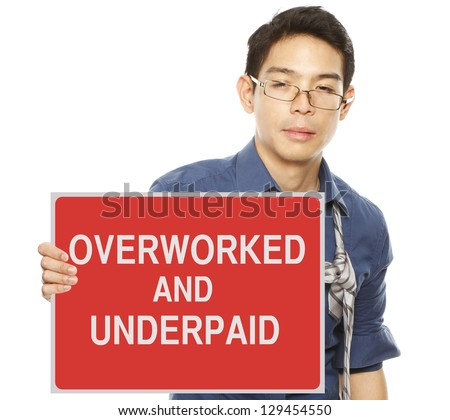 A tired and sleepy man complaining about work and pay - stock photo