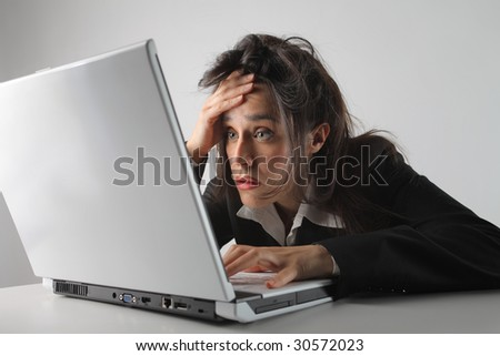 a tired business woman using laptop - stock photo