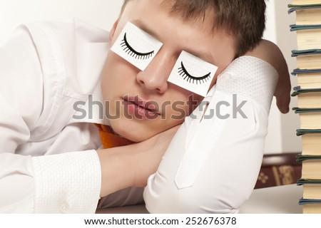 A tired businessman sleeping - stock photo