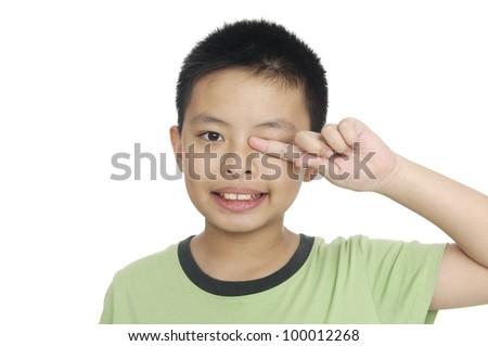 A tired little boy rubbing eyes, isolated on white - stock photo
