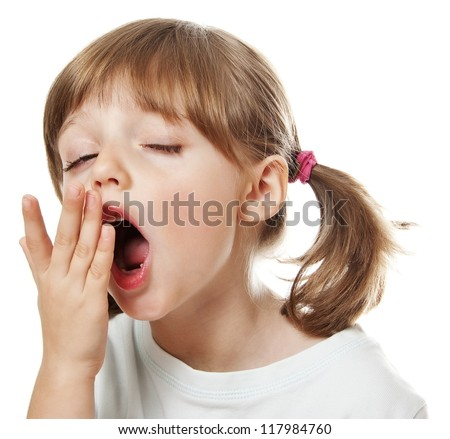 a tired little girl yawning - stock photo