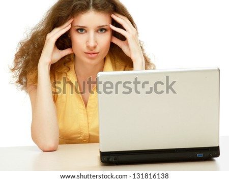 A tired woman in front of a laptop - stock photo