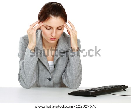 A tired woman sitting on the desk, isolated on white background