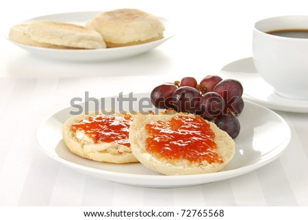 A toasted english muffin with black coffee - stock photo