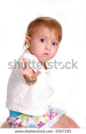 A toddler asking for more with an outstreched hand - stock photo